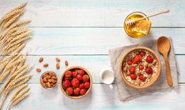 Healthy breakfast with oat flakes, natural milk, fresh strawberr Royalty Free Stock Photos