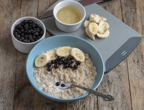 Breakfast: oatmeal with bananas and blueberries Stock Photo