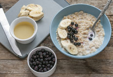 Breakfast: oatmeal with bananas and blueberries stock photos