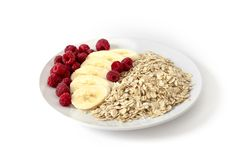 Oatmeal with berries and bananas Stock Image