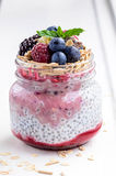Breakfast: oatmeal with berries, chia seeds and nuts. In a jar Royalty Free Stock Photos