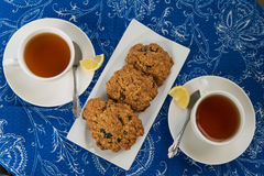 Breakfast with the oatmeal cookies and lemon tea Stock Photos