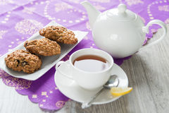 Breakfast with the oatmeal cookies and lemon tea Stock Images