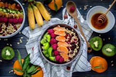 Breakfast: oatmeal with kiwi, raspberries, chia seeds and oranges. Top view. Good vegan breakfast with juicy fruits. All fruits are organic stock photo