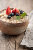 Breakfast oatmeal with milk and berries Royalty Free Stock Photography