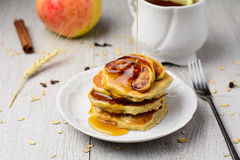 Breakfast oatmeal pancakes with caramelized apples Stock Image