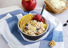 Breakfast oatmeal porridge with apples, raisins and walnuts Stock Photography