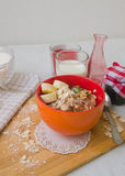 Breakfast oatmeal porridge with bananas, seeds, nuts and milk Stock Photos