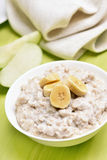 Breakfast oatmeal porridge with bananas slices Royalty Free Stock Photography