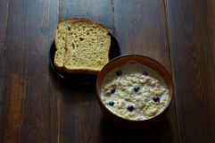 Breakfast with oatmeal porridge. With berries and sliced bread stock photo