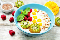 Breakfast oatmeal porridge with kiwi, mango, raspberry, banana a Stock Images
