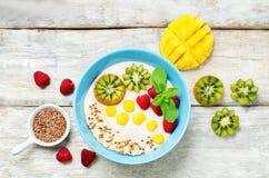 Breakfast oatmeal porridge with kiwi, mango, raspberry, banana a Royalty Free Stock Image