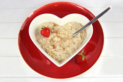 Breakfast of Oatmeal or Porridge in a heart bowl with strawberry Royalty Free Stock Photos