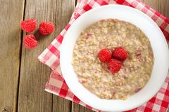 Breakfast oatmeal with raspberries overhead view Royalty Free Stock Image