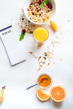 Breakfast with oatmeal and to do list on white background. Breakfast with oatmeal and orange juice, to do list on white background top view Royalty Free Stock Photo