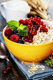 Breakfast with oats and berries Stock Photos