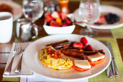 Breakfast with omelet, fresh fruits and coffee Royalty Free Stock Images