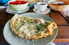 Breakfast with omelet and hot coffee Royalty Free Stock Photography