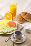 Breakfast with omelet Stock Photos