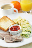Breakfast with omelet and veal tongue Stock Images