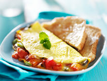 Breakfast omelette with buttered toast Royalty Free Stock Photography