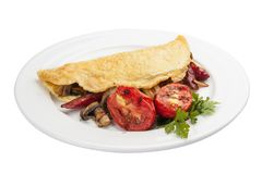 Breakfast. Omelette with sausage and tomatoes royalty free stock image