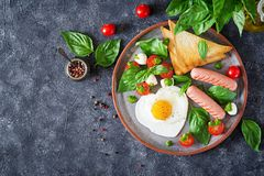 Free Breakfast On Valentine`s Day - Fried Eggs In The Shape Heart, Sausage, Toast And Caprese Salad Royalty Free Stock Image - 120104576