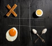 Breakfast option with egg. On a black wooden board Stock Photography