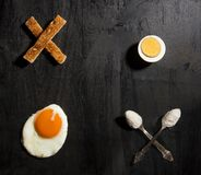 Breakfast option with egg. On a black wooden board Stock Image
