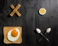 Breakfast option with egg. On a black wooden board Stock Images