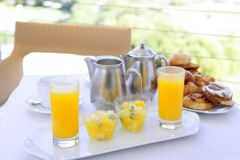 Breakfast with orange juice coffe tea milk Royalty Free Stock Photos
