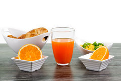 Breakfast with orange juice, croissant, scrambled eggs and a sli Stock Photo