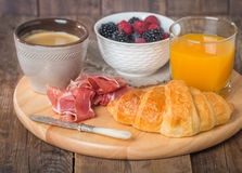 Breakfast with orange juice, fresh croissant Royalty Free Stock Photos