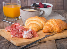 Breakfast with orange juice, fresh croissant Stock Photography