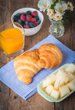 Breakfast with orange juice, fresh croissant Royalty Free Stock Images
