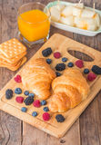 Breakfast with orange juice, fresh croissant Stock Photo