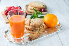 Breakfast with orange juice. And oatmeal cookies Royalty Free Stock Image