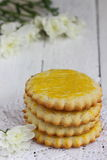 Breakfast on orange serviete. Baked cookie and flowers on white serviete Shallow DOF royalty free stock photography