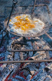 Breakfast outdoors: fried eggs on grill Royalty Free Stock Image