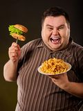 Diet failurFat man eating fast food hamberger. Stock Image