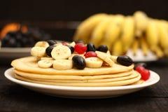 Breakfast pancake with honey and banana slices Royalty Free Stock Photos
