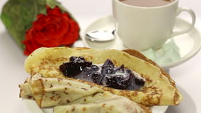 Breakfast with pancake and roses Royalty Free Stock Photography