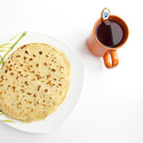 Breakfast Pancakes. With orange cup of tea Royalty Free Stock Photos