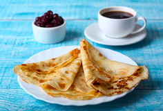 Breakfast pancakes with cherry jam on  blue background Stock Photos