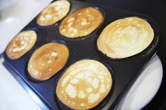 Breakfast with pancakes on electric oven Royalty Free Stock Image
