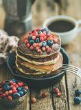 Breakfast with pancakes with forest berries and honey, wooden background Stock Images