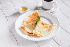 Breakfast pancakes with honey and coffee Royalty Free Stock Photo