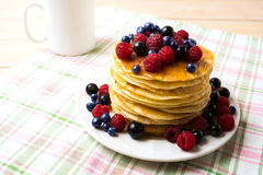 Breakfast pancakes with honey and fresh berries and coffee mug Royalty Free Stock Photography