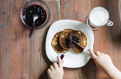 Breakfast with pancakes. And jam royalty free stock images