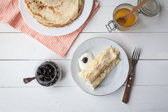Breakfast with pancakes, jam, honey Stock Images